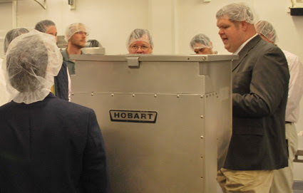 Dr. Dale Woerner (right) provides the delegation with a tour of the Center for Meat Safety and Quality at Colorado State University