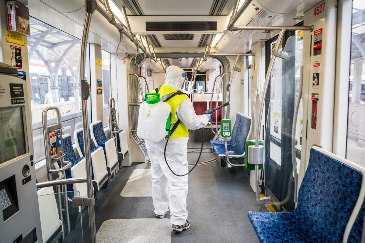 TTC employee disinfects streetcar