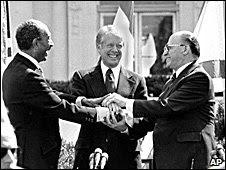 Egyptian President Anwar Sadat, left, U..S. President Jimmy Carter, center, and Israeli Prime Minister Menachem Begin clasp hands on the north lawn of the White House