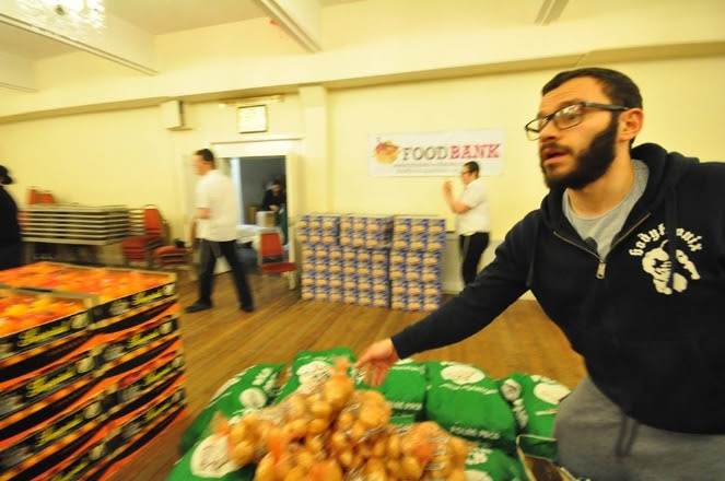 Foodbank Volunteers packing.jpg