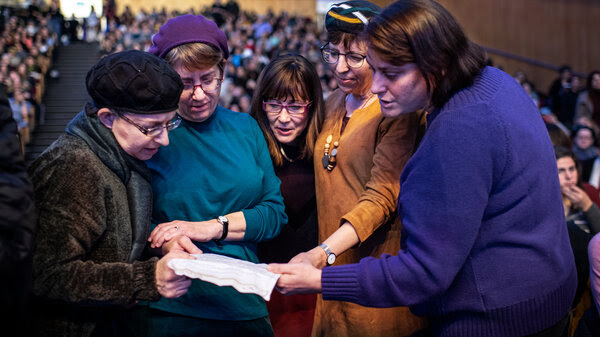 """Orthodox Jewish women are increasingly joining a custom called Daf Yomi, Hebrew for """"daily page,"""" which involves reading a page a day of the Talmud, a centuries-old, multivolume collection of rabbinic teachings, debates and interpretations of Judaism. Here women read the last pages of the cycle at their first women's mass Talmud celebration in Jerusalem in January."""