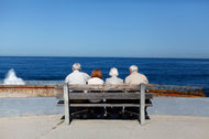 Couples along the beach in California, where a mandatory, state-run retirement plan will call for employers to automatically enroll workers, then start deducting 3 percent from each paycheck.