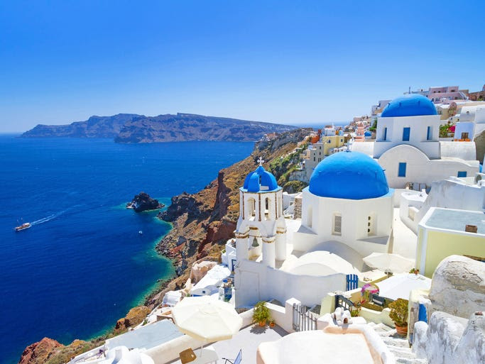 The Greek                                                           island of                                                           Santorini is                                                           dotted with                                                           white-washed,                                                           blue-domed                                                           churches, and                                                           they're all                                                           beautiful.                                                           Take your                                                             pick!