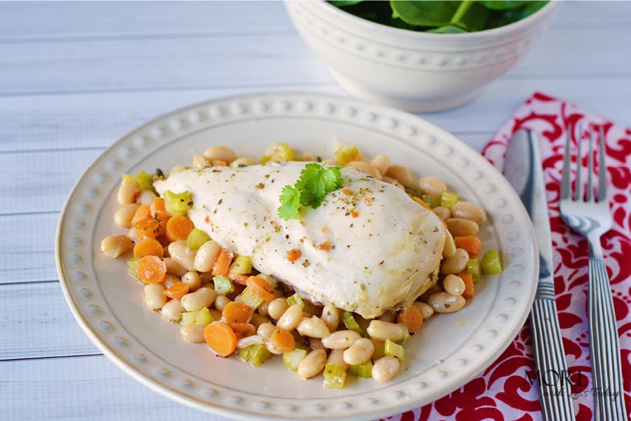 Individual serving plated of Slow Cooker Chicken with Rosemary and White Beans recipe