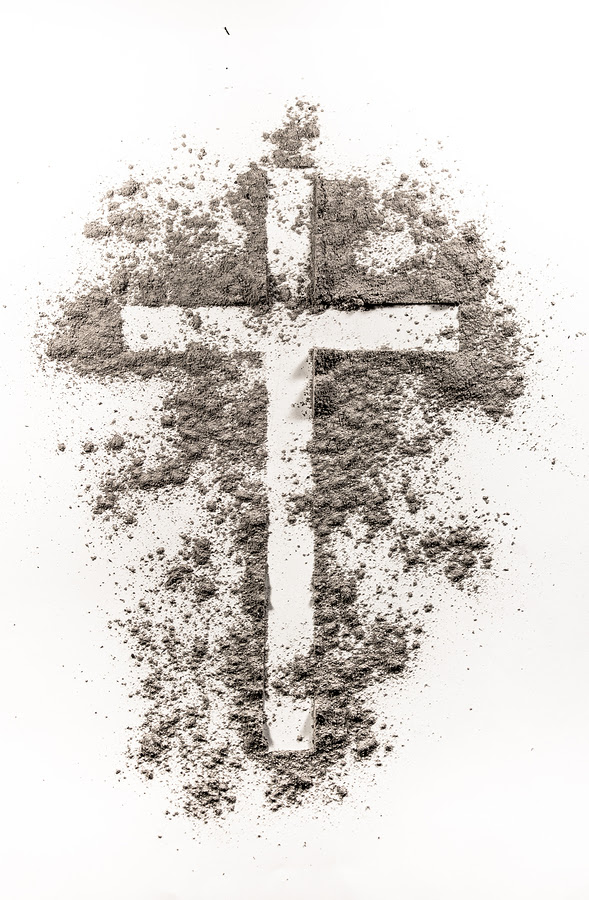 Christian cross symbol made of ash on a white background