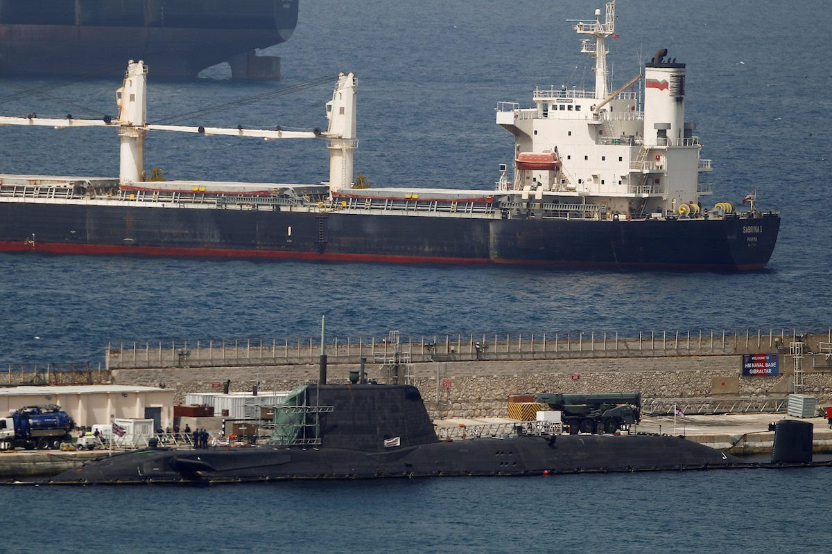 "A British nuclear Astute-class submarine HMS Ambush (Bottom) is seen docked in a port while it is repaired after it was involved in a ""glancing collision"" with a merchant vessel off the coast of the peninsula of Gibraltar on Wednesday, in the British overseas territory of Gibraltar, July 21, 2016. REUTERS/Jon Nazca"