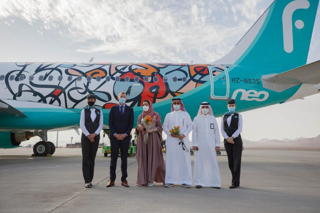 Group photo in front of flynas Aircraft.jpeg