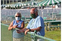 (L-R): Lisbeth Dodd and trainer Pat McBurney watch their horses work from the rail at Monmouth Park