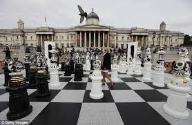 Image result for CHESS B0ARD WITH ROYAL FIGURES