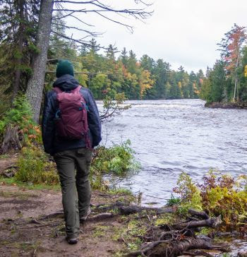 A person hiking wearing long pants and tall boots, which can help keep off ticks