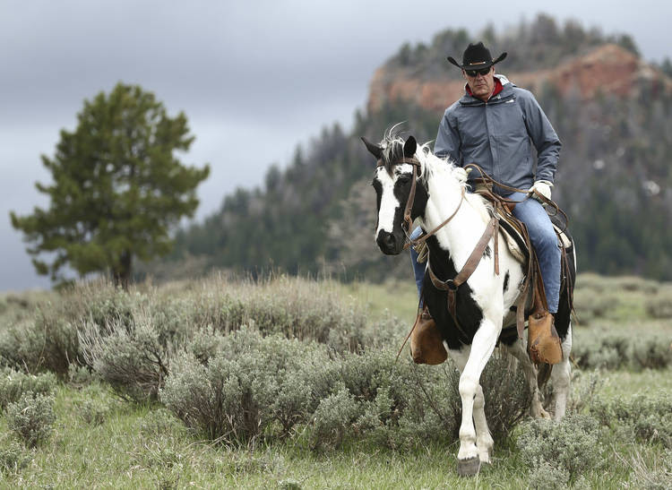 Interior Secretary Ryan Zinke enjoys a horseback ride in the Bears Ears National Monument. (Scott G Winterton/AP)