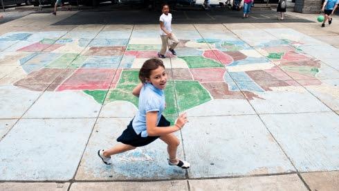Students running on playground.