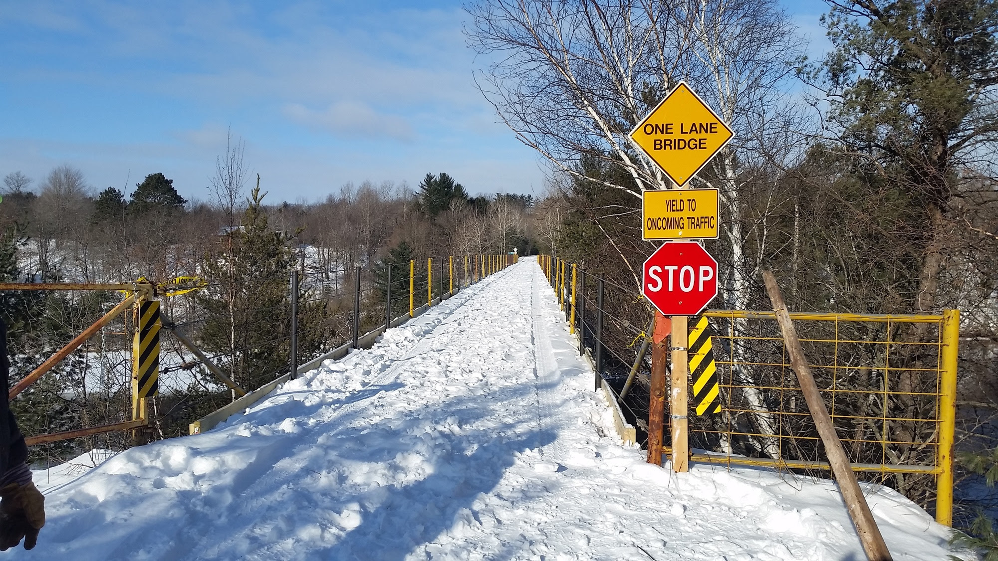 A Snowmobile Trail No. 2 bridge over the Menominee River, at the Michigan-Wisconsin border in Dickinson County, has now been reopened.