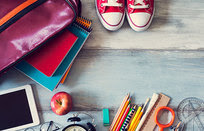 Picture of school related items. Backpack, pencils, rulers, tablet, notebooks