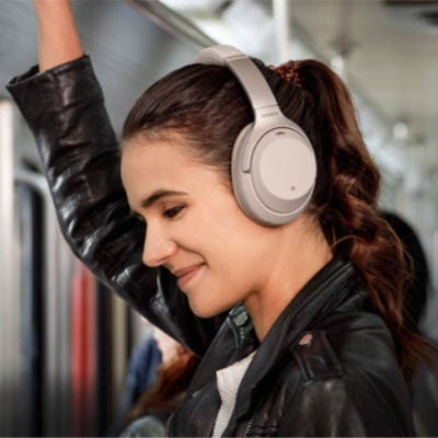 college girl using a good Christmas gift - wireless headphones