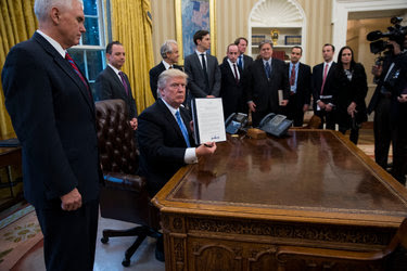 President Trump signed a presidential memoranda Monday, one of his first orders as president, freezing federal funding to health providers abroad who discuss abortion as a family-planning option.
