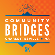 The sun rises from behind blue mountains. White letters read: Community Bridges 5k, Charlottesville, VA