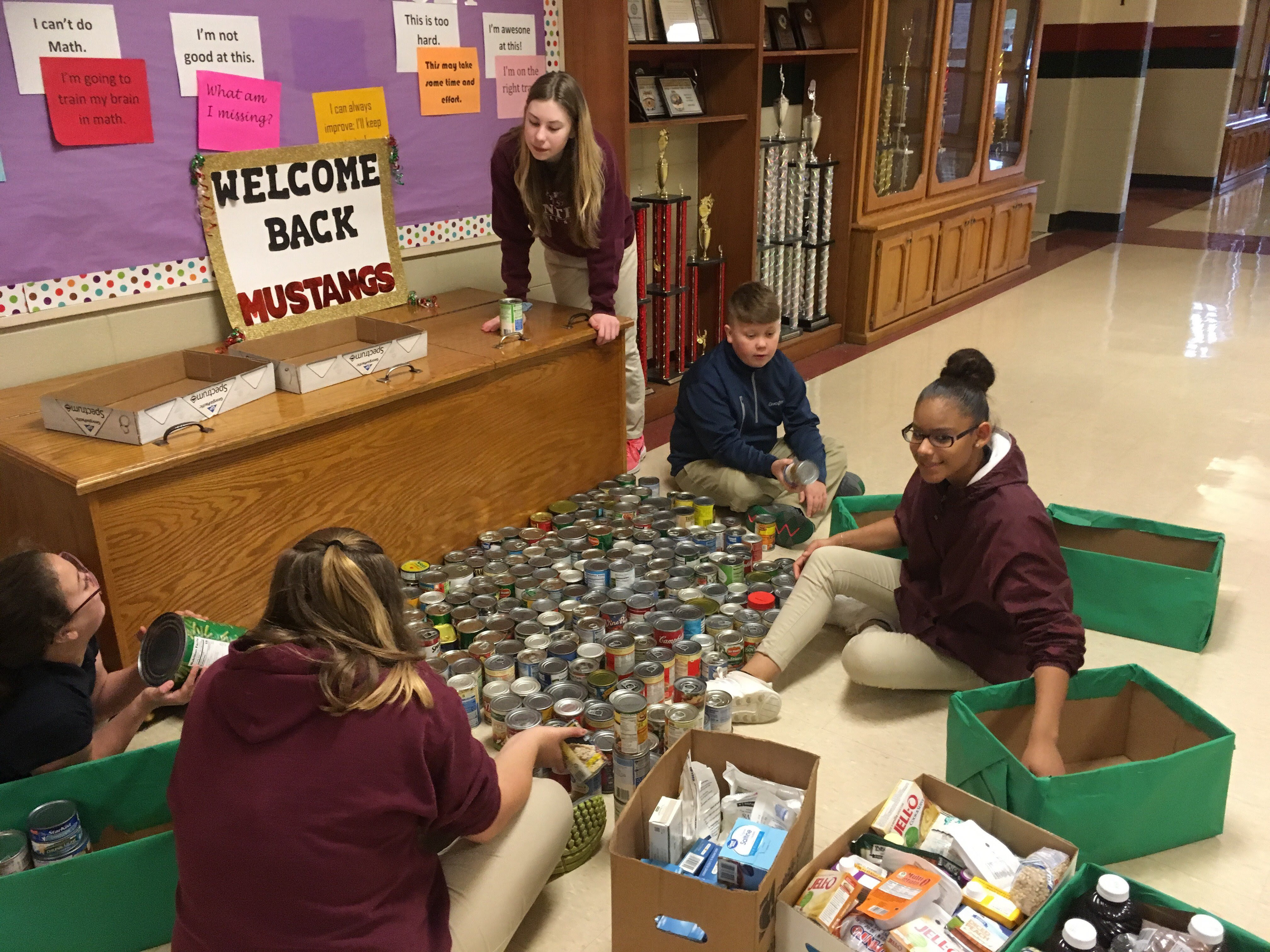 Central Middle students count cans
