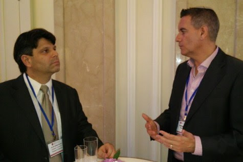 Ambassador Esteban Penrod Padilla of Costa Rica speaking with Mr. Ashley Perry, President of Reconectar, at the JPost Diplomat Conference.