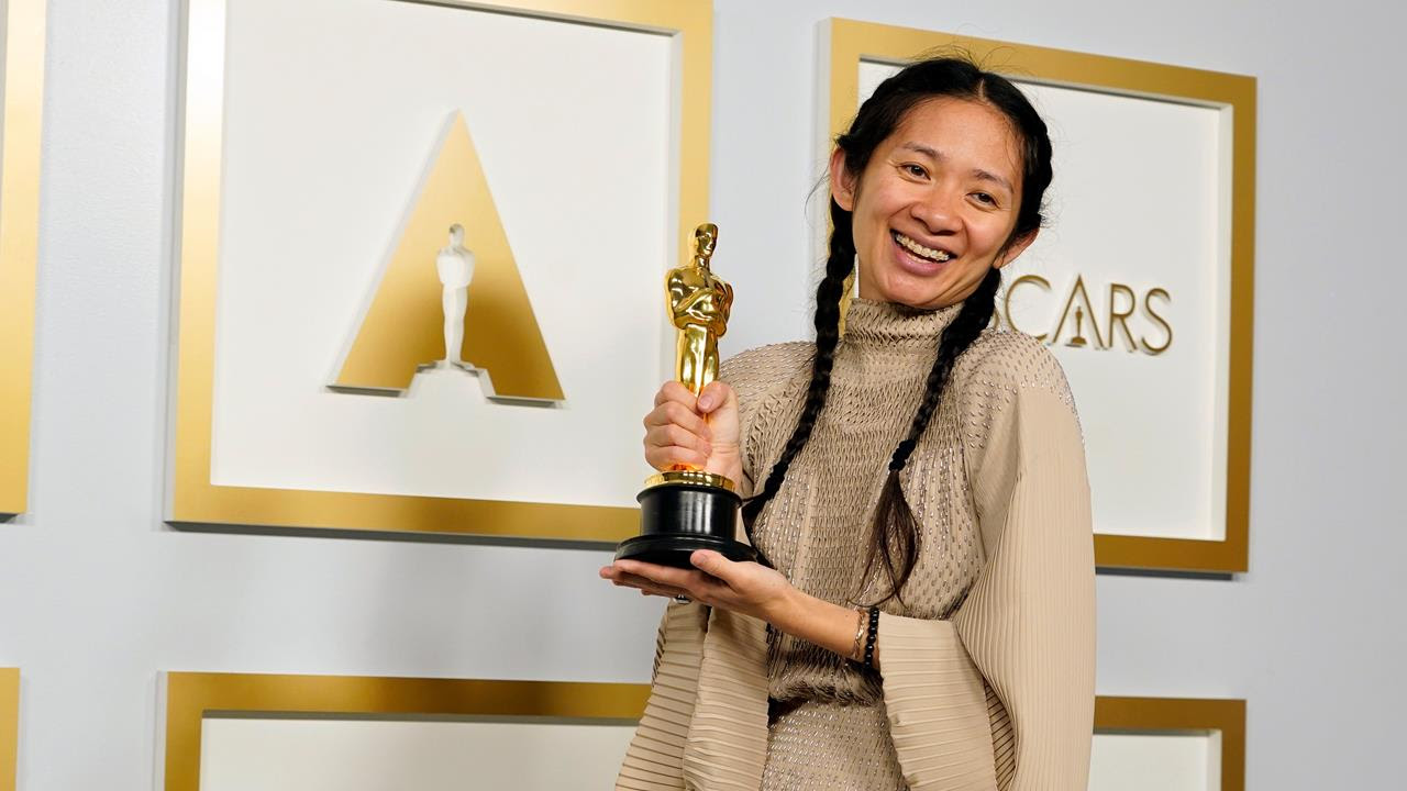 Director Chloé Zhao holds her Academy Award for Best Director.
