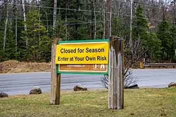 A closed for the season sign is shown from the Sugarloaf Mountain natural area in Marquette County.