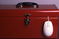 Stock photo of toolbox with computer mouse coming out.