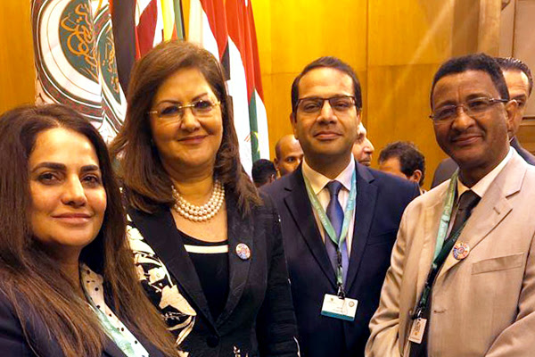(From left) Shahnaz Jaberi, a Baha'i representative from Bahrain; Hala Al-Saeed, a government minister from Egypt; Hatem El-Hady, a Baha'i representative from Egypt; and Solomon Belay, a representative from the Baha'i International Community's Addis Ababa office, at the Arab League headquarters in Cairo