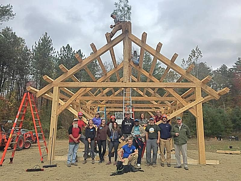 Construction team posing in front of the Pavilion during construction