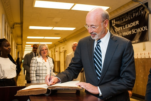 Governor Wolf signing the historic Central High Visitors Book