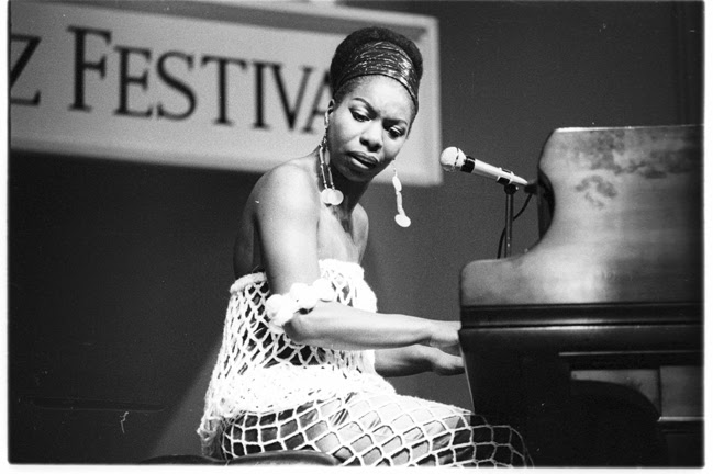 Nina Simone plays the piano and sings in concert.