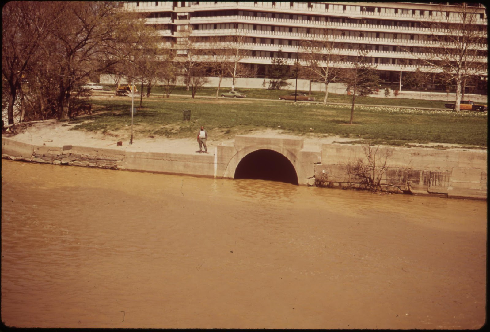 The Georgetown Gap, Through Which Raw Sewage Flows Into The Potomac. Watergate Complex In The Rear, April 1973 | by The U.S. National Archives