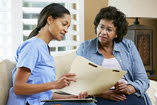 Picture of a healthcare worker talking to a patient