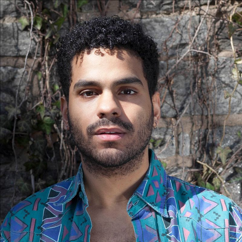 """Marketing Fellow Gerard Minaya is a genderqueer, Afro Latino person in a 5'8"""" attuned body with kinky-curly hair."""