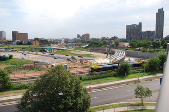 Crews construct a flyover above Interstate 35W to tie the METRO Green Line to the Blue Line in Minneapolis