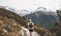 Man walking down a mountain track