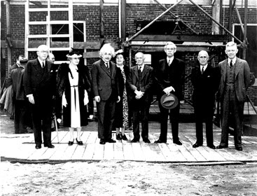 DEDICATING FULD HALL: Albert Einstein takes center stage for this photograph on May 22, 1939 at the dedication ceremony for the Institute for Advanced Study's new building, Fuld Hall. From left: Alanson B. Houghton, C. Lavinia Bamberger (Louis Bamberger's sister), Albert Einstein, Mrs. Abraham Flexner (the successful Broadway playwright Anne Crawford), Abraham Flexner, John R. Hardin, Herbert H. Maass, and President of Princeton University Harold W. Dodds.(Image Courtesy of Institute for Advanced Study, Shelby White and Leon Levy Archives Center)