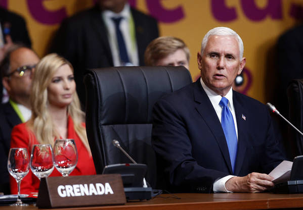 Vice President Pence speaks at the plenary session of the Americas Summit in Lima, Peru, on April 14. (Karel Navarro/Associated Press)</p>
