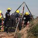 Rescue workers tried to free minerswho became trapped while working illegally in an old gold-mine shaft in Benoni, South Africa, on Sunday.