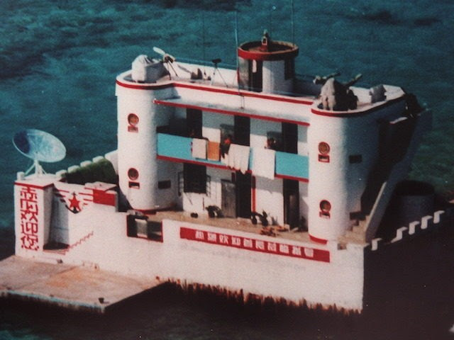 SPRATLY ISLANDS:This undated photograph taken in late 1998 by a Philippine Air Force reconaissance plane and released by the Philippine military Western Command 20 March 1999 shows a two-storey Chinese garrison built in the disputed Johnson Reef, armed with naval guns on the rooftop located in the disputed Spratly islands …