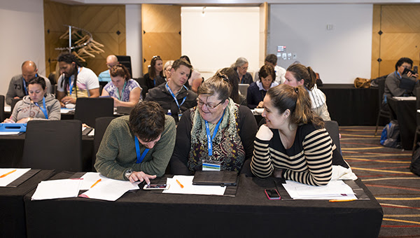 Delegates in a conference breakout session