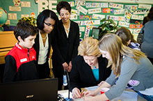 Associate professor Michelle Williams (left) and Angela DeBarger watch as U.S. Sen. Debbie Stabenow learns about the STEMGenetics curriculum.