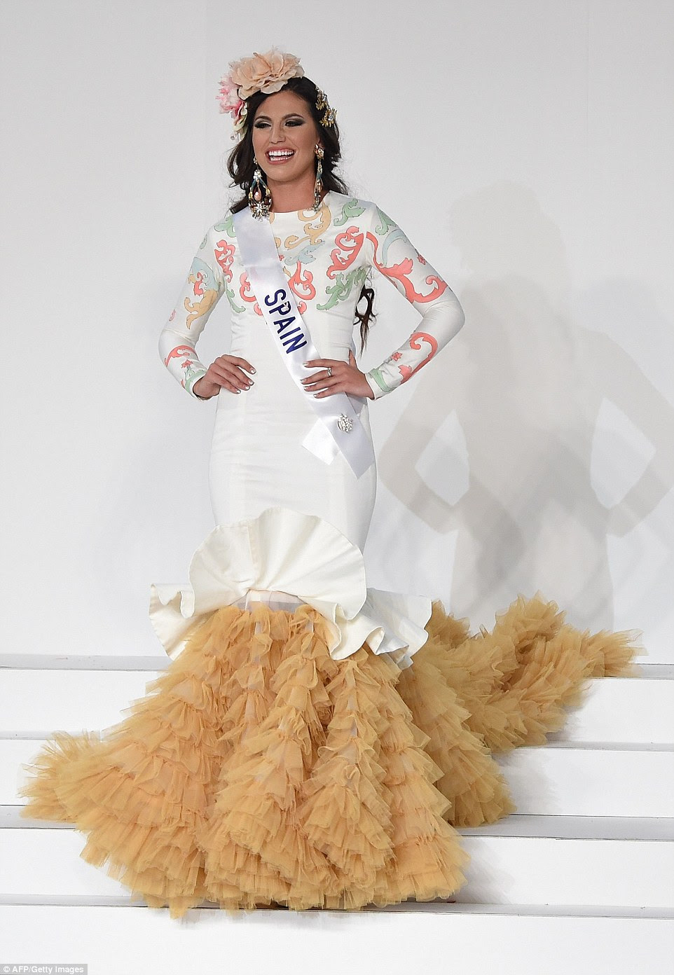 Of course Miss Spain had to have a flamenco-inspired skirt, with layers of tulle swinging as she walked. But Cristina Silva forewent the traditional red for a soft ivory with pastel swirls on the sleeves and top of her high-neck body-hugging dress