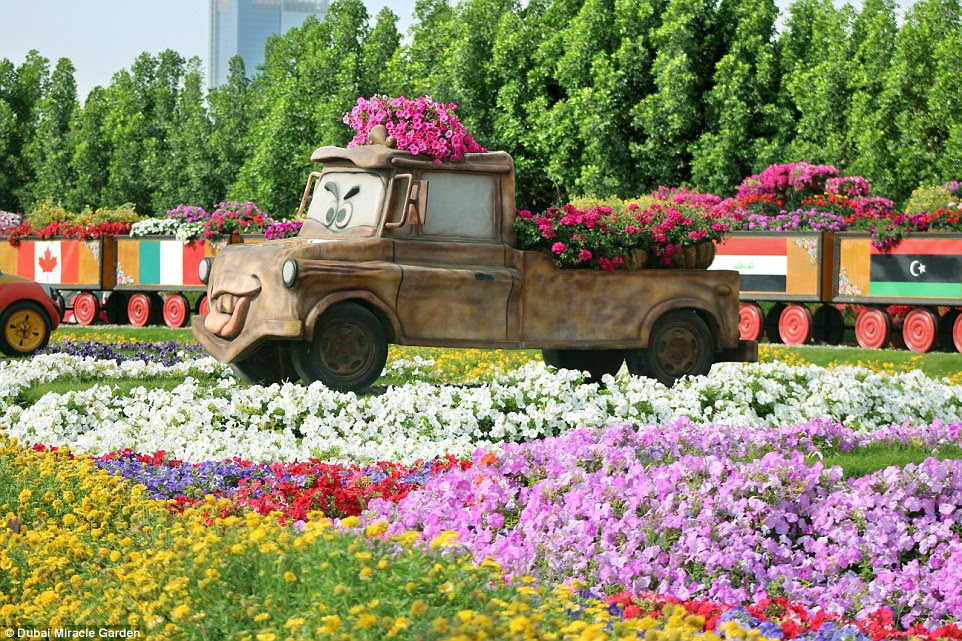 Even                                                            Disney characters                                                            such as Mater from Cars can                                                            be seen at the Dubai oasis,                                                            of course decorated with                                                            flowerbeds