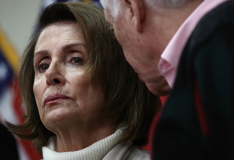 "Nancy Pelosi confers with Steny Hoyer during the House Democratic caucus ""Issues Conference"" in Baltimore. (Win McNamee/Getty Images)</p>"