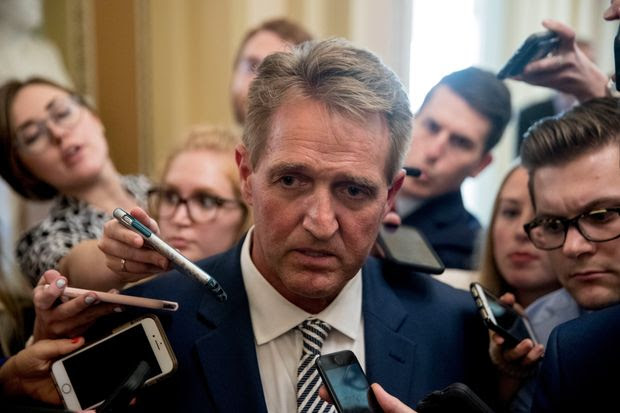Sen. Jeff Flake speaks with reporters after meeting with Senate Majority Leader Mitch McConnell in the Capitol, Washington, D.C., Sept. 28.