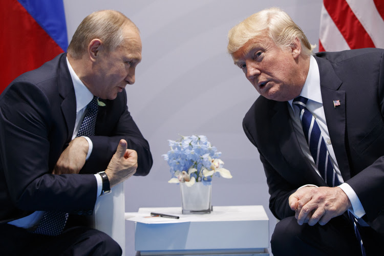 Trump speaks to Vladimir Putin during their second conversation at the G-20 Summit in Hamburg. (Evan Vucci/AP)