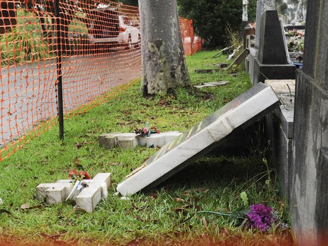 One of the toppled headstones. Picture: Phillip Rogers