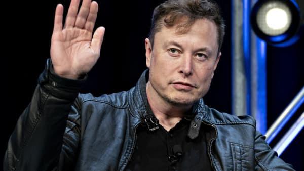 Elon Musk waves