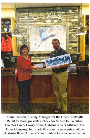 Adam Hudson, Fishing Manager for the Orvis Huntsville Retail location, presents a check for $2,500 to Executive  Director Cindy Lowry of the Alabama Rivers Alliance. The Orvis Company, Inc. made this grant in recognition of the  Alabama River Alliance's contribution to  area conservation.