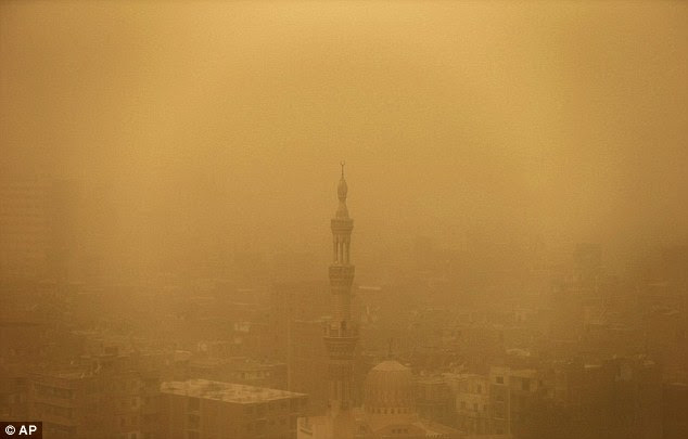 The sandstorm hit Egypt after unusually warm and sunny weather for a February day, and the sky over downtown Cairo turned yellow and blotted out the sun, limiting visibility
